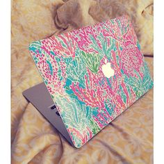 Show off your beloved Macbook in your favorite Lilly print!