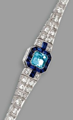 PLATINUM, AQUAMARINE, SAPPHIRE AND DIAMOND BRACELET, CIRCA 1925.
