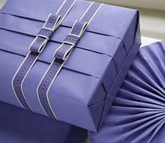 Pleated gifts. DIY gift wrapping idea. There is only the image on this but I really like it. Do some folds on your gift wrap and then center it in the way you want. This simple ribbon idea goes well - it shows off the pleats. Also DIY paper craft idea on other projects.