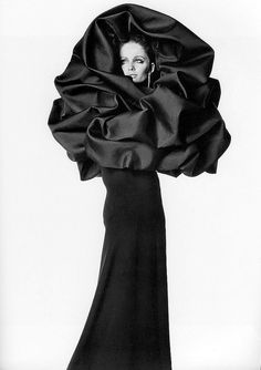 "Sue Murray wearing Balenciaga's evening dress of black silk crépe with ""chou"" wrap of black silk gazar, photo by Irving Penn, Vogue, Sept. 15, 1967"