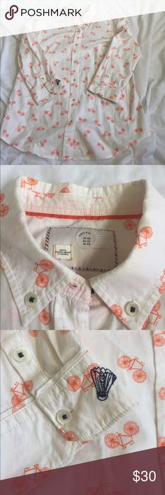 postmark anthropologie bicycle button up size 2 SUPER CUTE postmark (anthro!) button up top with orange bicycles. great condition though there is a tiny mark on the left sleeve. it may come out with a good wash but the price is discounted just in case! size 2. bundle with other items for an even deeper discount! 🤗😜 Anthropologie Tops Button Down Shirts