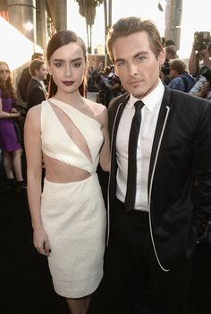 Lily Collins in Cushnie Et Ochs dress with cutouts  & Kevin Zegers in black blazer with white collar trim