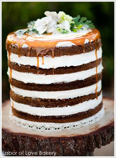 this looks delish, minus the caramel sauce. im assuming that is ice cream in the layers...?  maybe a dense chocolate espresso cake with ice cream and kahlua drizzle?  yes please!