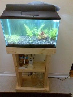 DIY Aquarium Stands In Various Styles And Sizes . A DIY aquarium stand will showcase the fish tank so it can become the focal point of the room and a great conversation piece. Save money and get the custom built piece of furniture you want by d Turtle Aquarium, Aquarium Fish, Diy Aquarium Stand, Painted Bathroom Floors, Fish Tank Stand, Cool Fish Tanks, Diy Upcycling, Coastal Art, Diy Painting