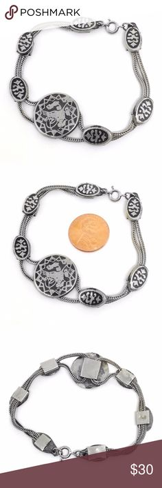 """*SALE* Bracelet Bali Enamel Exquisite!! Double strand wheat chain bracelet with enameled medallions. Chain is 1.6mm thick, doubled approx 4mm wide. Measures 7.25"""" length. Medallions have abstract geometric patterns with black inlay. Center circle is 3/4"""". Small ovals are 8 x 12mm. Weight 16.1 grams. Note: Made of Alpaca silver which contains no sterling, though is a metal alloy made to look like sterling silver. Perfect on its own or in addition to your stacks. Chic! Vintage Jewelry…"""