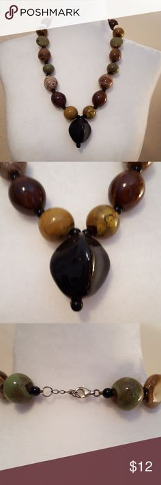 Stone necklace Green, brown, and black stone necklace. Very unique. Jewelry Necklaces
