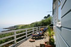 Driftwood #Cornwall #coastal #dining #hotel Cornwall Hotels, Cornwall Beaches, Driftwood Hotel, Fishing Villages, Hotel S, Garden Bridge, New England, Beach House, Outdoor Structures