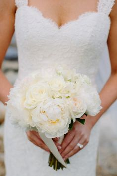 Classic wedding bouquet idea - all-white bouquet of roses and peonies {Stacey Hedman Photography}