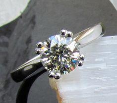 Diamond Solitaire Platinum Engagement Ring Round Brilliant Cut Diamond. $6,963.00, via Etsy.