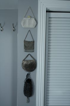 Vintage purses displayed in a group look so neat!