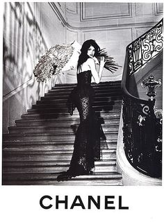 Black sleek and sultry Chanel...where is she going? I love the raised panel and the wrought iron railing too...