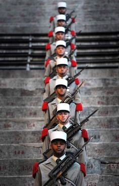Soldiers of the 1st Foreign Cavalry Regiment of the French Foreign Legion stand guard during a rehearsal for a commemorative ceremony