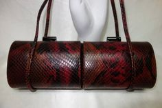 Originally: $229.  Darling purse in the popular baguette style, by Rodo. Made in Italy. Two compartments which open separately. Snake embossed
