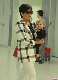 Kris Jenner Carries Penelope Disick Through Athens Airport