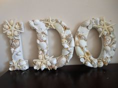 White seashell letters for a beach wedding, handmade by me! Available in my Etsy shop shellsunlimited.etsy.com