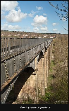 The Pontcysyllte Aqueduct, full name in Welsh: Traphont Ddŵr Pontcysyllte, is a navigable aqueduct that carries the Llangollen Canal over the valley of the River Dee in Wrexham County Borough in north east Wales. Completed in 1805, it is the longest and highest aqueduct in Britain, a Grade I Listed Building and a World Heritage Site.