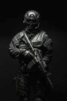 Buy Spec ops police officer SWAT by Getmilitaryphotos on PhotoDune. Spec ops police officer SWAT in black uniform and face mask studio shot Military Police, Military Weapons, Military Art, Ghost Soldiers, Swat Police, Police Officer, Tactical Armor, Military Special Forces, Army Wallpaper