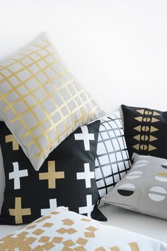 Gold, black, white and grey pillows. Oleander + Palm designs.
