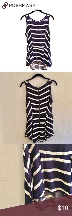 Navy & white striped peplum tank Xhilaration peplum tank from Target. Worn once. No damage. Super flattering and cute with jeans or white pants and a sweater. Zipper in back. Happy to answer any additional questions! Fits true to size. Xhilaration Tops Blouses