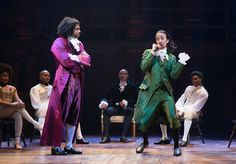 """Daveed Diggs, standing left, and Lin-Manuel Miranda in the musical """"Hamilton"""" at the Richard Rodgers Theater."""