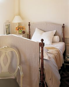 A simple fabric cover refinishes an old wooden headboard (and footboard) without requiring any scraping, sanding, or painting. Choose heavyweight fabric for this project; it works like instant upholstery, softening the lines of the wooden form underneath.
