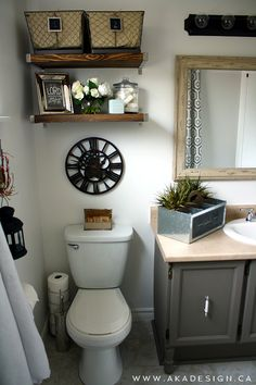 We turned an ugly bathroom into a thing of beauty! Check out this vintage industrial glam bathroom reveal!