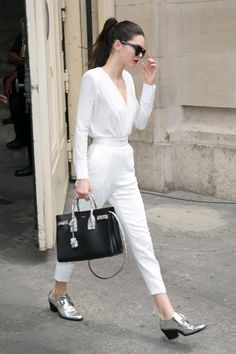 98aaf737c38 Kendall walks through Paris in a crisp all-white look. The metallic shoes  make
