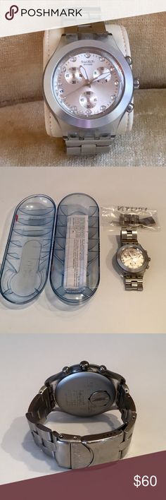 Swatch Watch in Silver This Full Blooded Swatch Watch is in very good used condition. This silver Watch with crystal details comes with the original case and extra links and pins. The glass face is lightly scratched.  The Watch needs a new battery (around $5). Swatch Accessories Watches