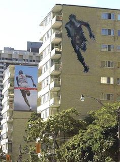 """Nike's """"Run Through The Wall"""" ad spans two buildings: the first one's got a cracked image of the building in the shape of the running man, while the second one has the actual runner with the Nike logo Marketing Viral, Guerrilla Marketing, Guerrilla Advertising, Street Marketing, Funny Advertising, Creative Advertising, Advertising Design, Funny Ads, Advertising Ideas"""