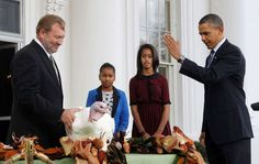President Barack Obama, with daughters Sasha and Malia, pardons Liberty, a 19-week old, 45-pound turkey, on the occasion of Thanksgiving, Wednesday, November 23, 2011, on the North Portico of the White House in Washington.
