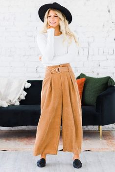 "Trust us when we tell you, these are a must! Our Cayden Wide Leg Pant is is the perfect Goucho Pant. This wide leg cropped pant is perfect for date night outfit or as a work pant. Our pants are so soft, with a perfect fit and wide leg. These are the perfect transitional pant! ant! Model Info: Model is 5'7"", Size 2, Wearing a small Inseam Measures 26"" on size medium Rise Measures 15"" on size medium Waist Measures 27"" on size medium 85% Polyester, 15% Cotton Wide Leg Pants, Perfect Fit, Trust, Size 2, Lounge, Legs, Running, Medium, Cute"