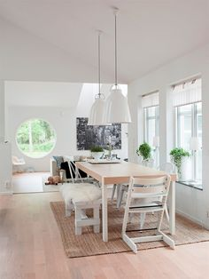Scandinavian dining table with Stokke chair