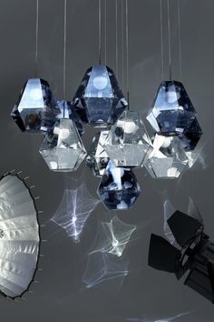 "OOOOOH! Cut diamonds hanging from the ceiling!!!!! Tom Dixon explores ""futuristic optics"" with lighting launches in Milan"