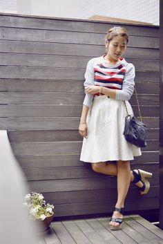 Japanese blogger Tomoko wears a Gap stripe raglan sweatshirt paired with a white skirt for a casual yet cute date look.