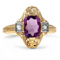 Two old European diamonds accentuate a cushion-shaped buff top amethyst in this captivating Edwardian ring. Intricate 14K yellow gold detailing adds to the splendor of this lovely piece from the 1920's (approx. 0.06 total carat weight).
