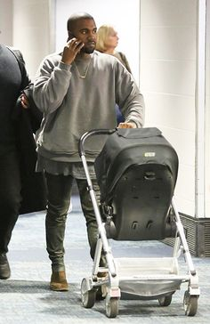 Kanye West Pushes North West in Stroller While Kim Kardashian Parties - Us Weekly