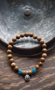 Namaste bracelet | Yoga om bracelet from Pillow Book Jewelry Aquamarine Bracelet, Book Jewelry, Yoga Gifts, Yoga Fashion, Blue Gemstones, Namaste, Birthstones, Zen, Gifts For Her
