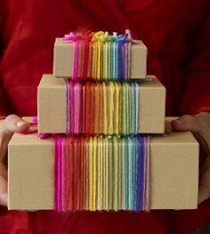 Pretty gift wrap! Kraft paper or plain box and rainbow of yarns...