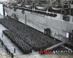 World War II Photograph: Thousands of soldiers of Hitler's once mighty Wehrmacht stand on the wharves of a French port for embarkation aboard a Coast Guard-manned troop transport to the United States.  They are a small part of the stream of Nazi warriors who are finding a way out of their lost cause by surrendering to the Allied armies surging across Germany.