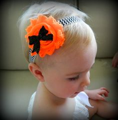 Halloween headband. Orange shabby flower with black sequin bow. Attached to black & white Chevron elastic headband! Great price and low shipping!