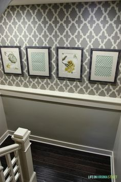Stenciled basement staircase and DIY fabric art. Great update for a hard to decorate space!