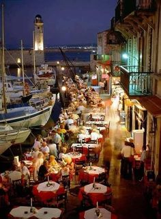 People Dining at Harbour Fish Restaurants in Rethymnon Crete Greece
