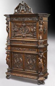 130: Elaborately carved walnut bureau cabinet : Lot 130