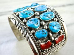 A classic piece from the South West, this bracelet features Ten ovals of beautiful blue Turquoise (likely Kingman) and four rectangle red Coral gems.