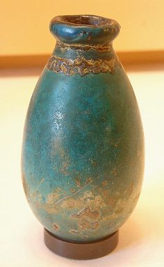 Egyptian Faience Ceramic Vessel, (Louvre);The Egyptians invented( & became masters of )the process of enameling long ago.Blue Egyptian ceramic glazes are incomparably lovely,the envy of artists across time & continents who have tried to copy those luminescent blues.The ancient glazes  have resisted the ravages of Time, & are still brilliant today! Egyptians were also among the first to use hand-powered potter's wheels.
