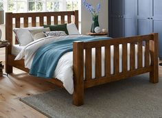 The Moore is a classic and timeless design, featuring a chunky wooden frame with sturdy side rails and a bulky head and foot end.