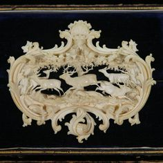Carved ivory deer brooch.  Unreal such detail could be carved onto a small brooch like this! Beautiful!
