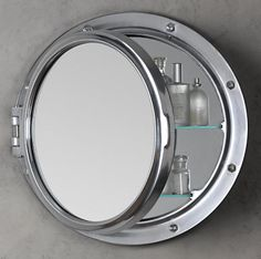ROYAL NAVAL PORTHOLE MIRRORED MEDICINE CABINET from http://www.restorationhardware.com/. Click through to see more porthole mirrors for the bathroom.