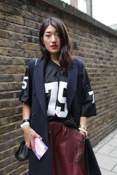 Super Bowl Style - How to Make a Sports Jersey Look Chic - navy long vest over a black jersey, paired with an oxblood leather midi skirt with sporty perforated pockets