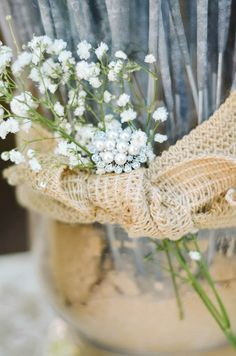 reception welcome table decorated with babys breath and lace